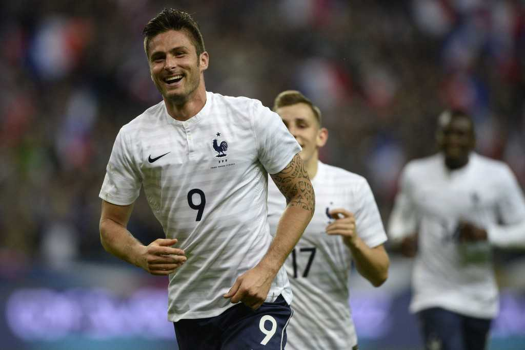 France's forward Olivier Giroud gestures as he celebrates the scoring of a goal during a friendly football match between France and Norway at the Stade de France in Saint-Denis near Paris, on May 27, 2014, ahead of the 2014 FIFA World Cup football tournament. AFP PHOTO / FRANCK FIFE        (Photo credit should read FRANCK FIFE/AFP/Getty Images)