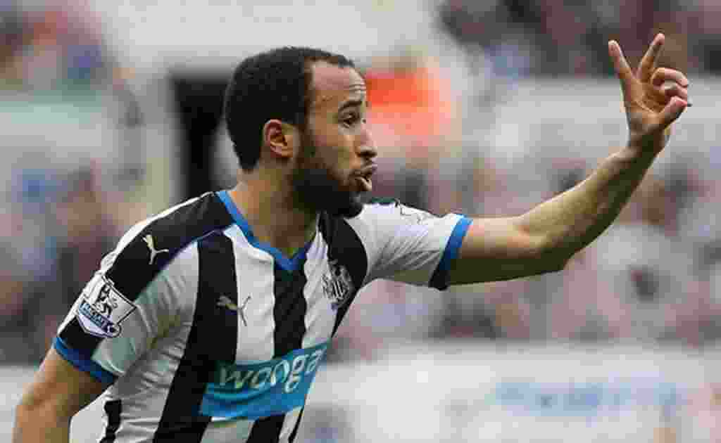 Andros Townsend Holding Up Two Fingers