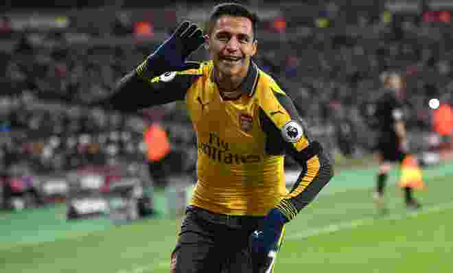 Arsenal's Chilean striker Alexis Sanchez celebrates after scoring their second goal during the English Premier League football match between West Ham United and Arsenal at The London Stadium, in east London on December 3, 2016. / AFP / Justin TALLIS / RESTRICTED TO EDITORIAL USE. No use with unauthorized audio, video, data, fixture lists, club/league logos or 'live' services. Online in-match use limited to 75 images, no video emulation. No use in betting, games or single club/league/player publications.  /         (Photo credit should read JUSTIN TALLIS/AFP/Getty Images)