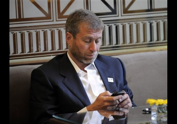 Chelsea owner Roman Abramovich checks his phone at a hotel in Johannesburg, South Africa prior the World Cup kick off, Thursday, June 10, 2010. Russia makes a bid for the soccer World Cup 2018. (AP Photo/Martin Meissner)